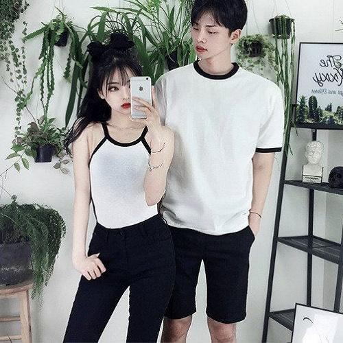 This summer style is cool, both are wearing the same style trousers with white tees.