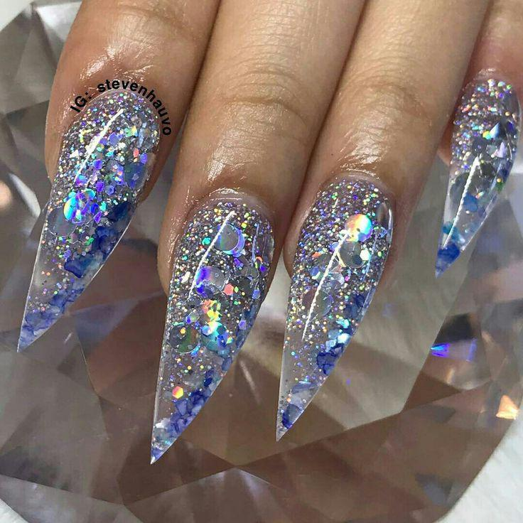 Glitter nails that reflect rainbows…