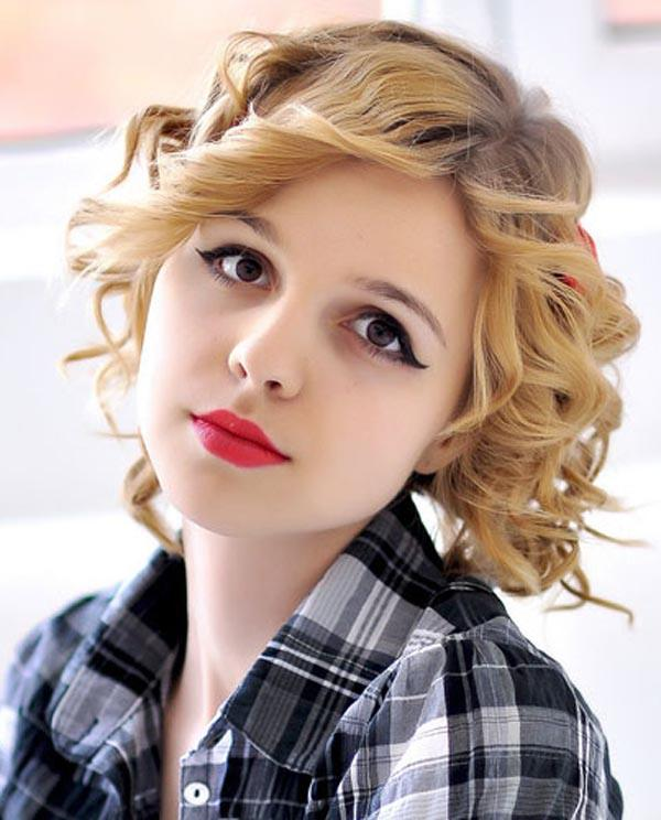 Curly and wavy hairstyle with golden brown hair color