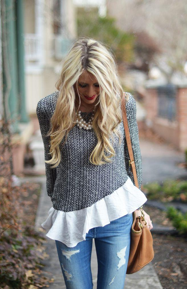 An asymmetric knitted long-sleeve sweater looks damn hot with white flared top, pearl necklace a ...