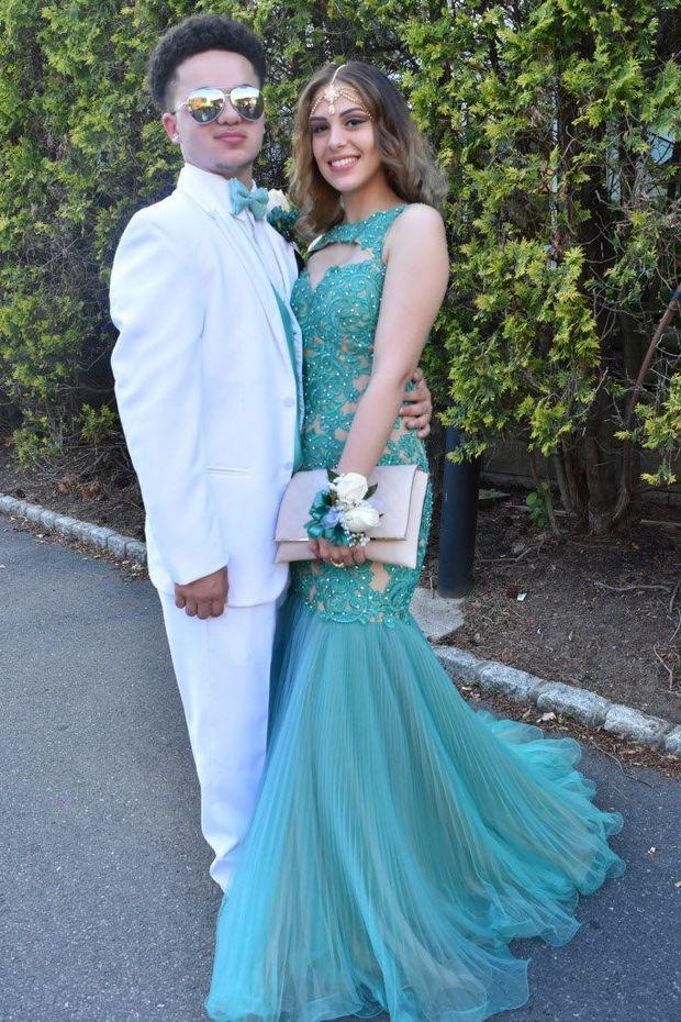 Torri Stanton and Donovan Moretti dress in turqouise and white at Wagner High School's pro ...