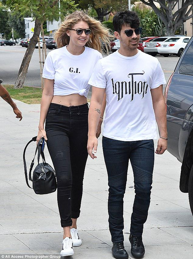 Cute Matching Couple Outfit – Gigi Hadid and Joe Jonas wear matching outfits on lunch outing..
