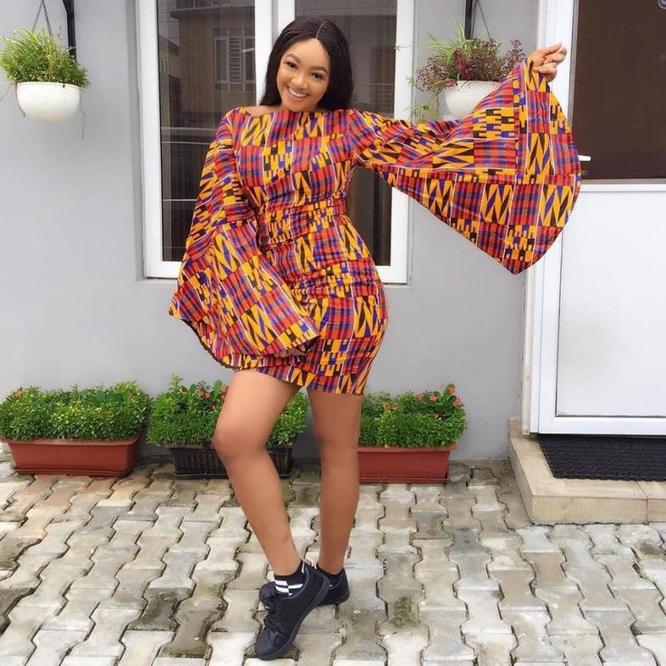 Ankara gowns with sneakers on Stylevore