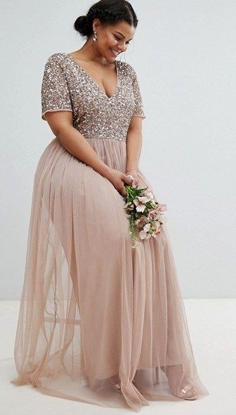 Plus size wedding guest dresses on Stylevore