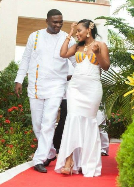 Traditional matching white african outfits for couples on