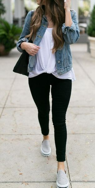 Black leggings with white t shirt and jean jacket on Stylevore