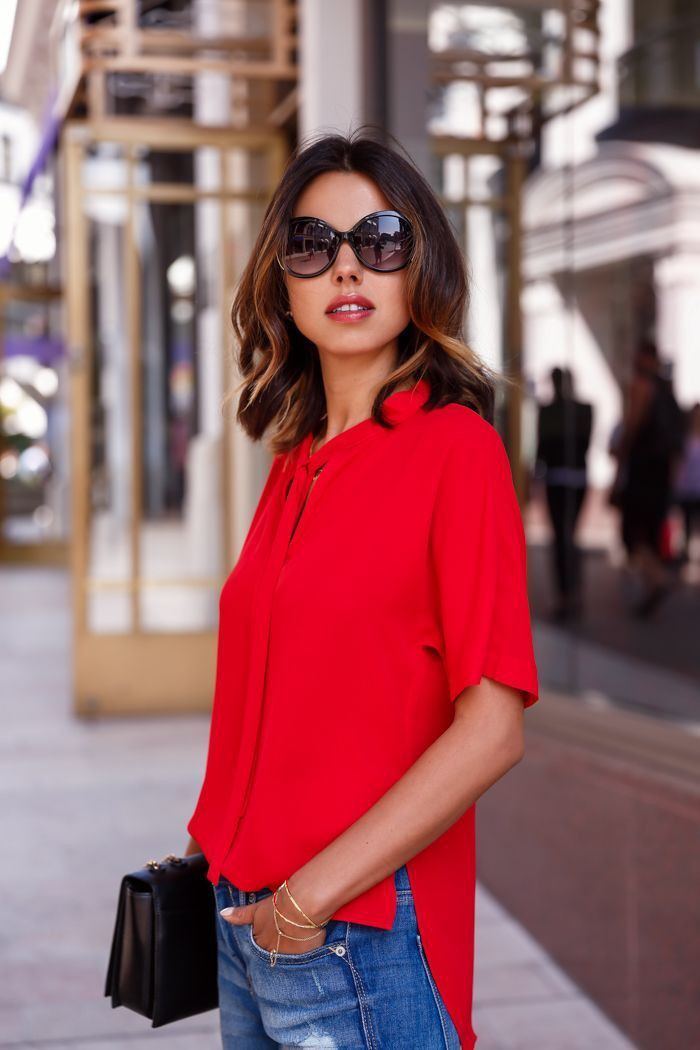 Red blouse with blue jeans
