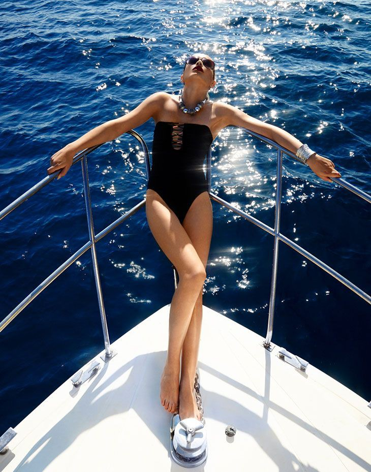 Absolutely nice and beautiful yacht woman, One-piece swimsuit