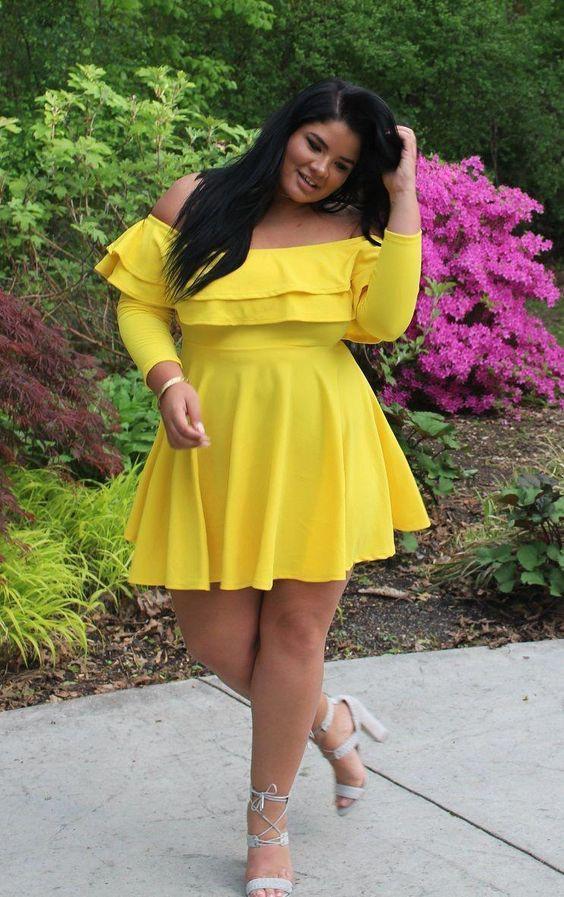 Plus-size model mustard yellow frock