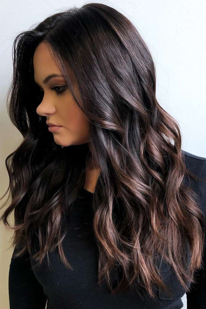 Medium length black hair with highlights