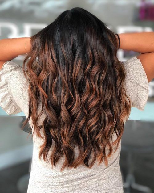 Curly black hair with highlights