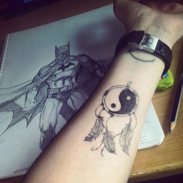 Dreamcatcher yin yang tattoo, Lower-back tattoo