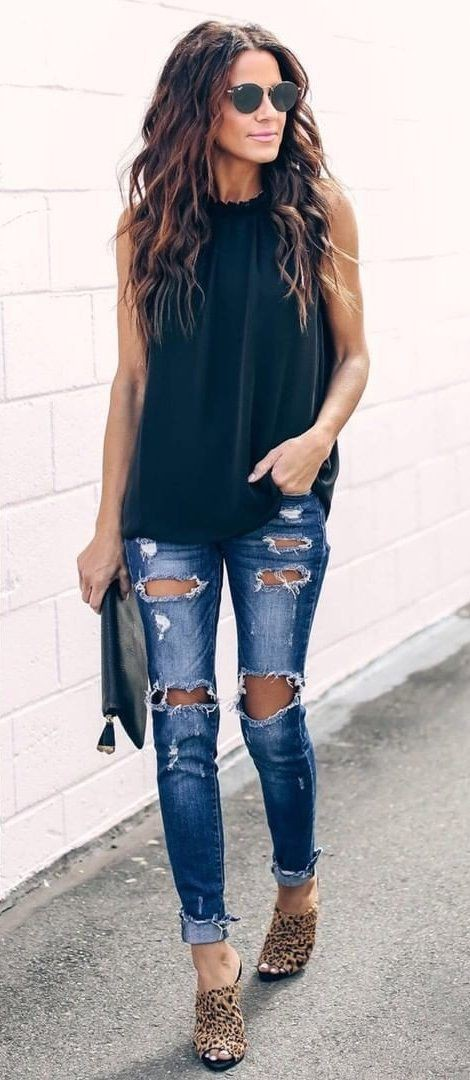 Black sleeveless top and jeans