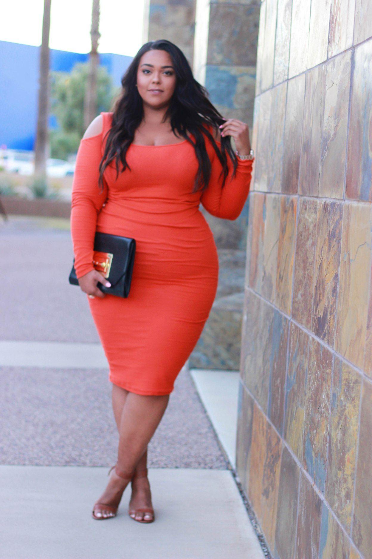 Orange dress with black shoes