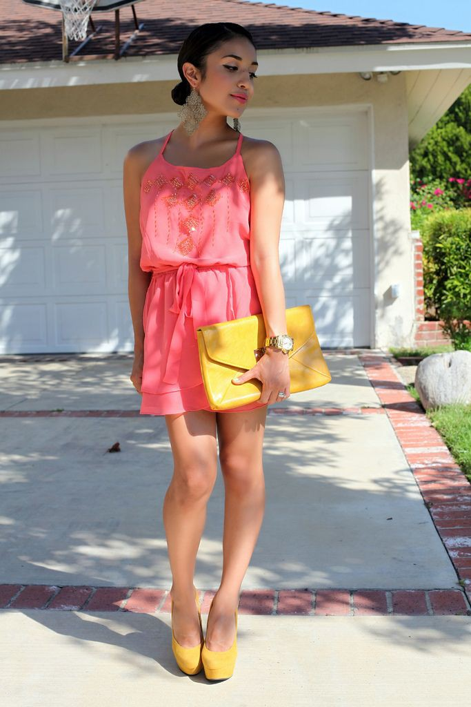 Pink outfit and yellow shoes