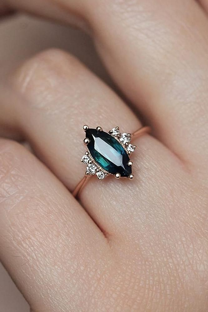 Marquise emerald rose gold engagement ring