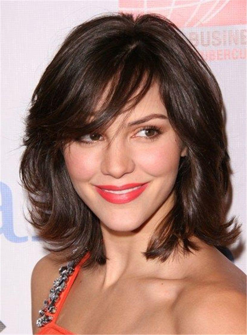 Medium length layered hair with bangs