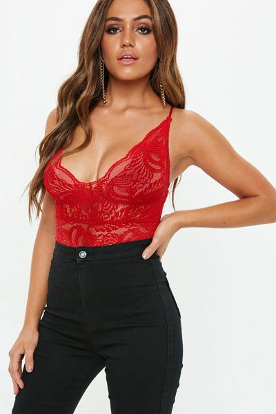 Red lace bodysuit with black jeans