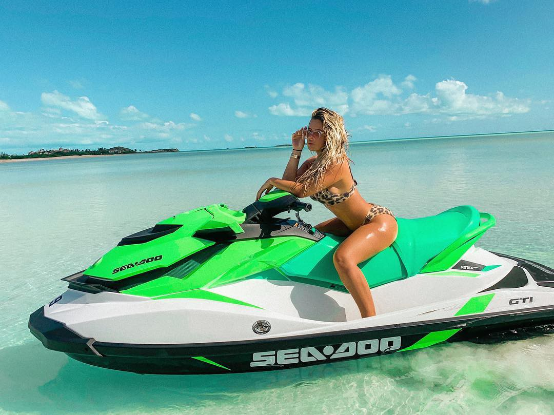 Kendall jenner poses in a cute floral print bikini as she has fun on a jet ski