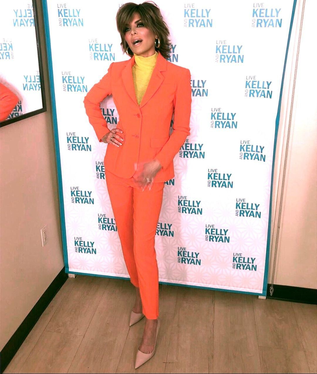 Lisa rinna in orange and yellow