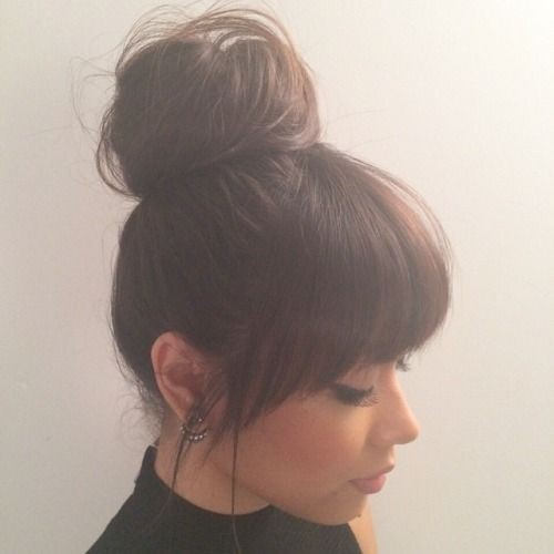 High messy bun with bangs