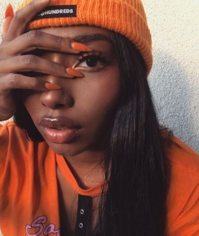 Orange nails on black girl