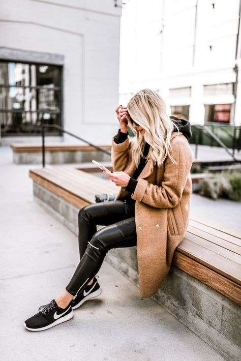 Camel coat and black shoes