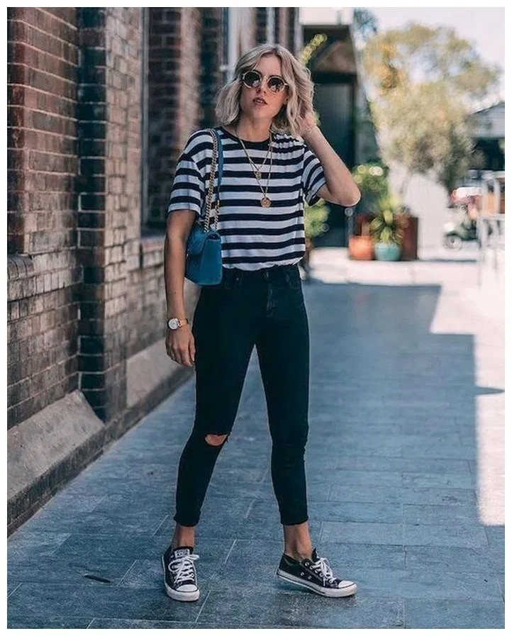 Black ripped jeans with striped shirt