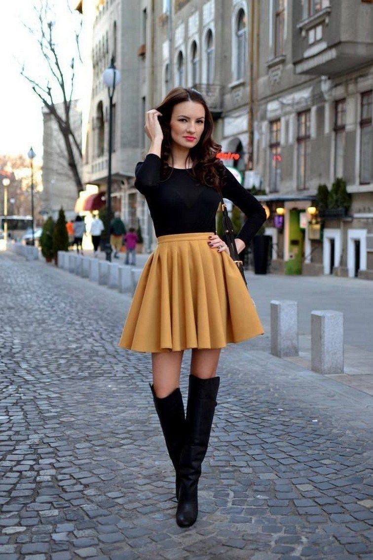 Pleated mini skirt and boots
