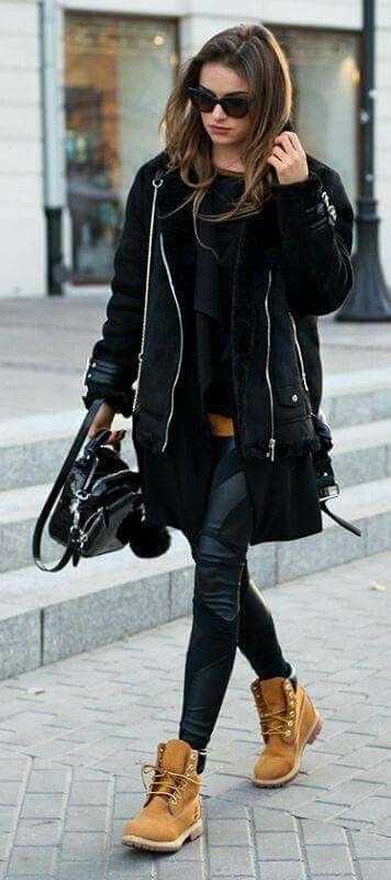 Black timberland boots on women