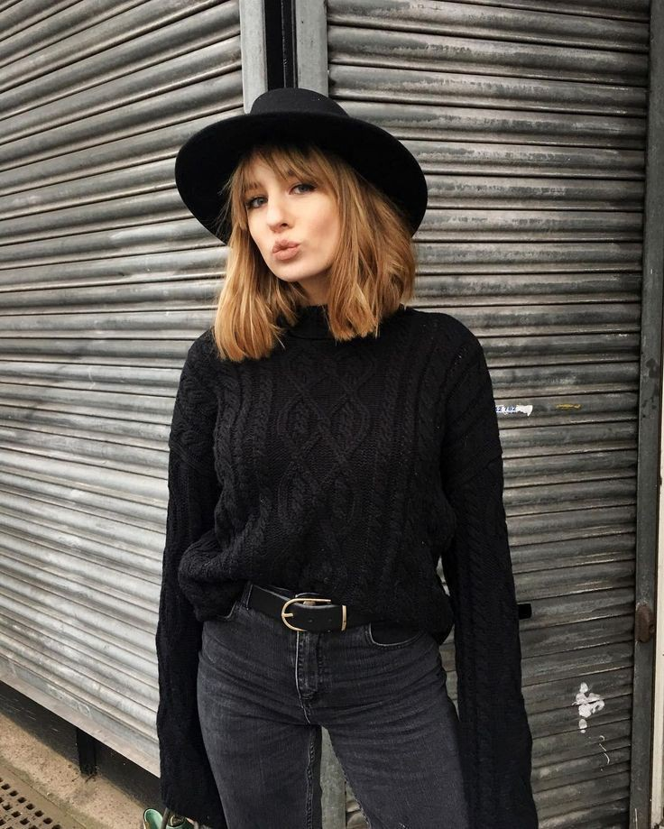 Black outfit style with trousers, sweater, fedora