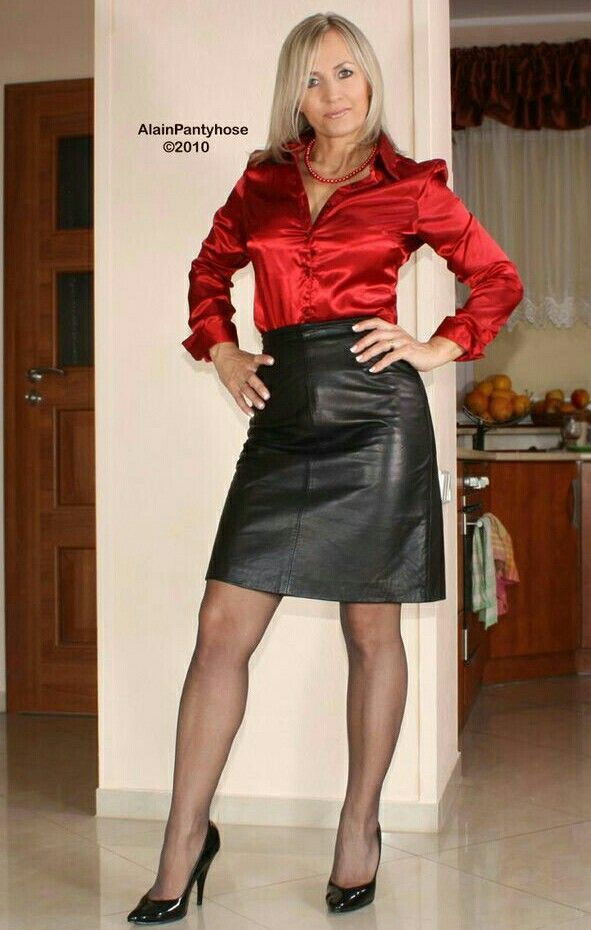 Women in leather skirts and blouses