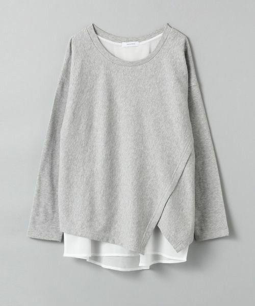 White lookbook dress with sweatshirt, trousers, sweater