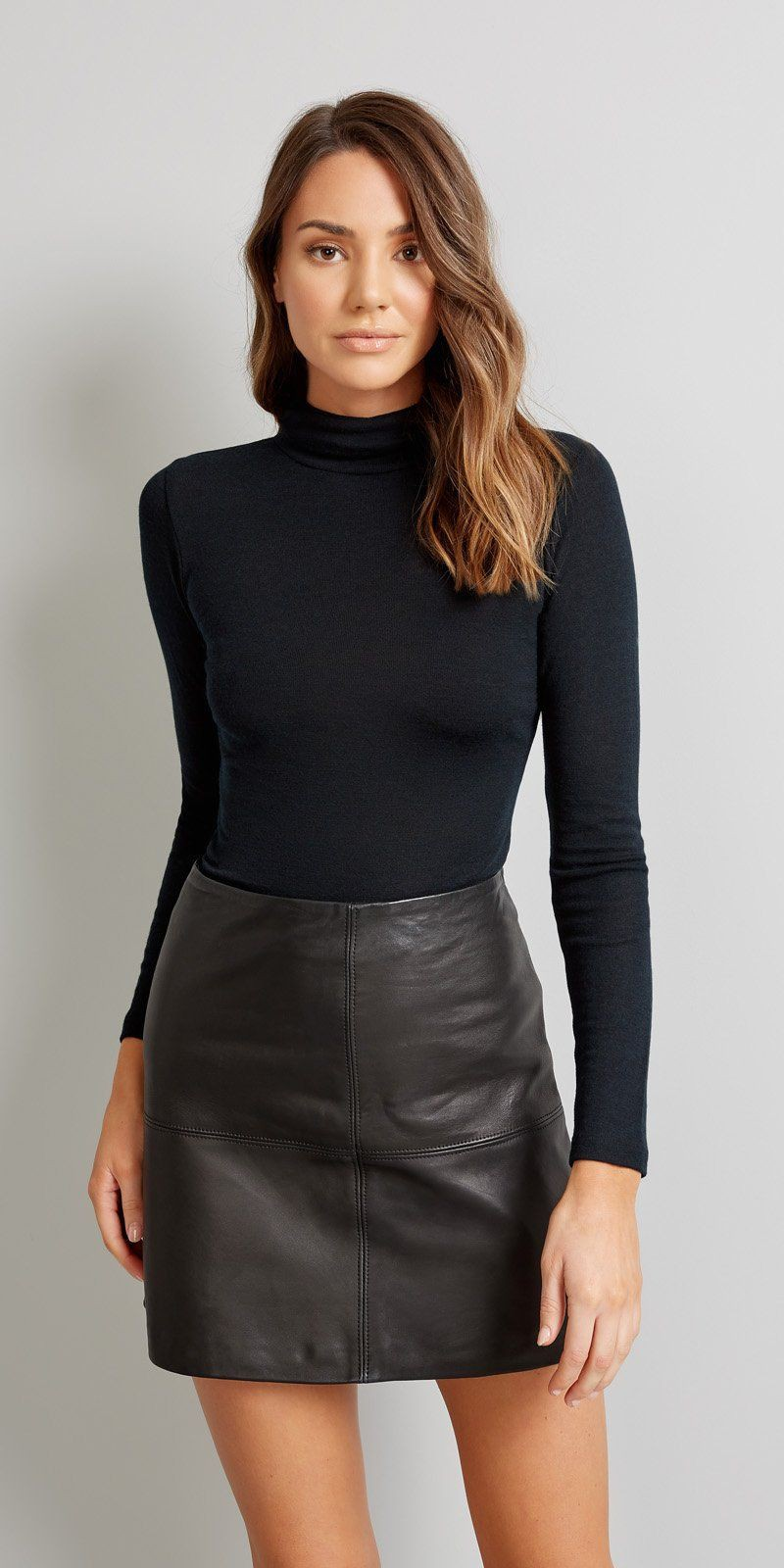 Leather skirt and polo neck