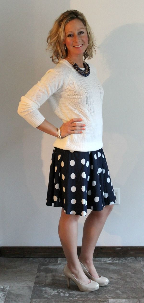 Sweater over polka dot skirt