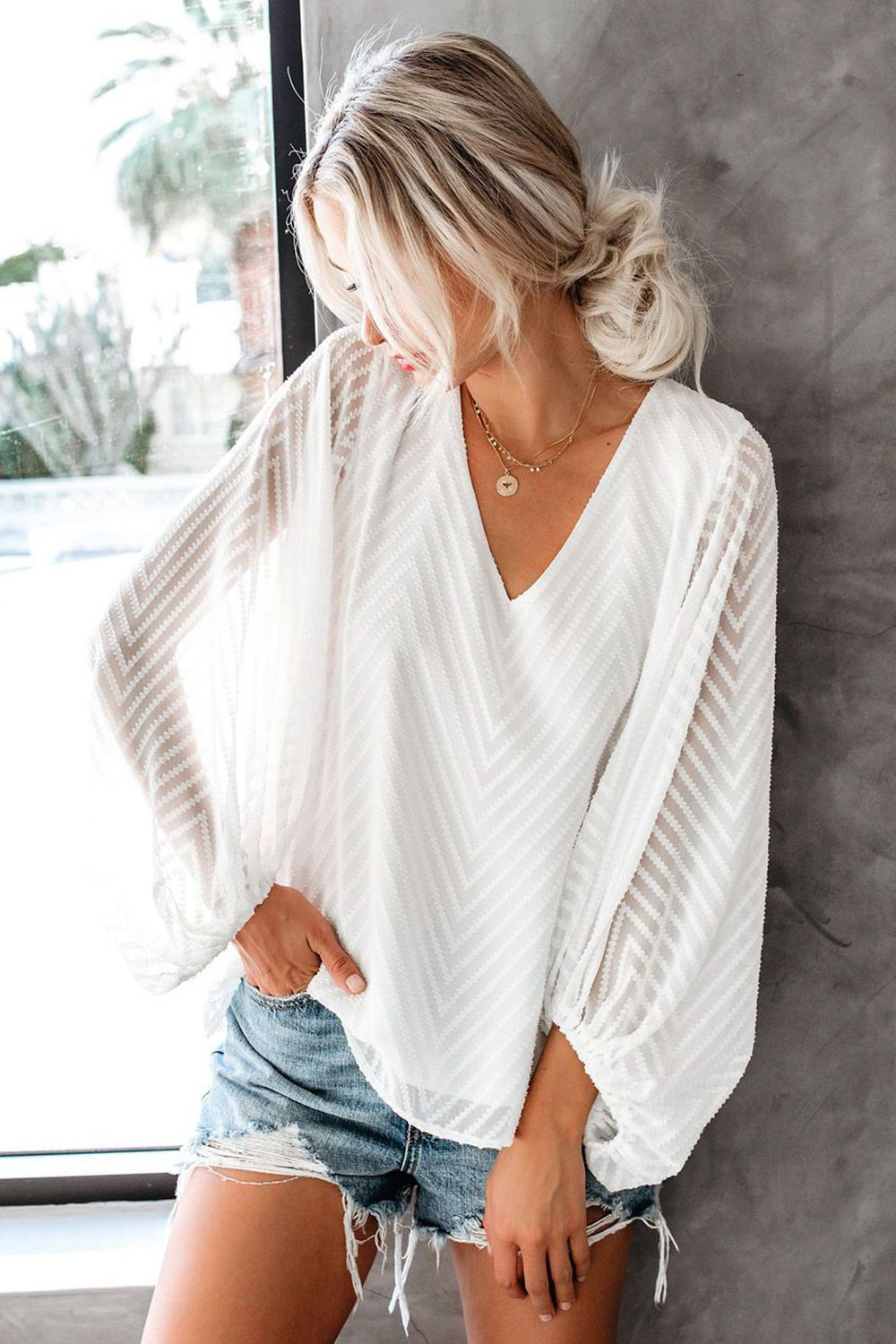 White lookbook fashion with sweater, blouse, shirt