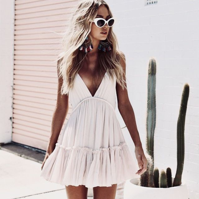 White colour outfit with little black dress sunglasses, eyewear
