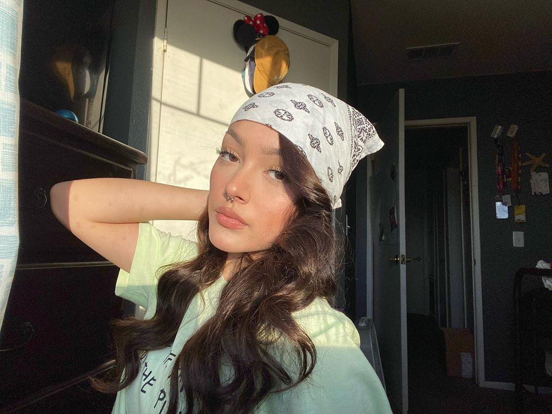 Hailey Orona beanie colour outfit, fun pic, Lips Smile