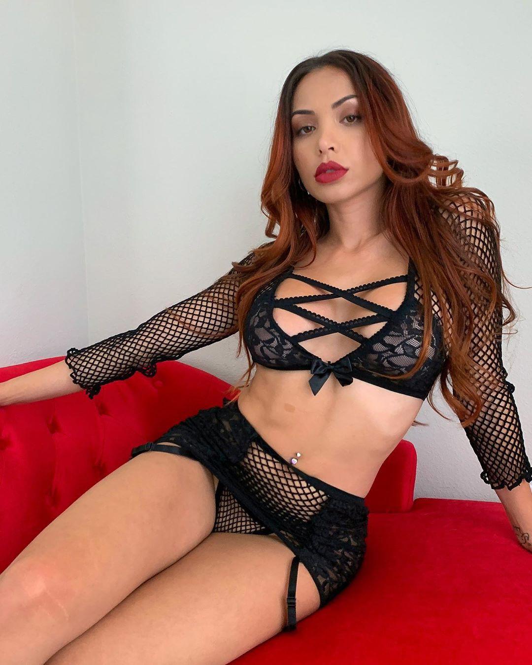 Maddy Belle lingerie fetish model, stocking colour dress