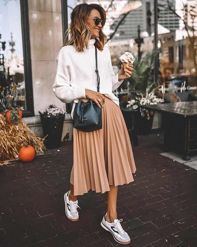 Beige and white colour combination with sweater, skirt, denim