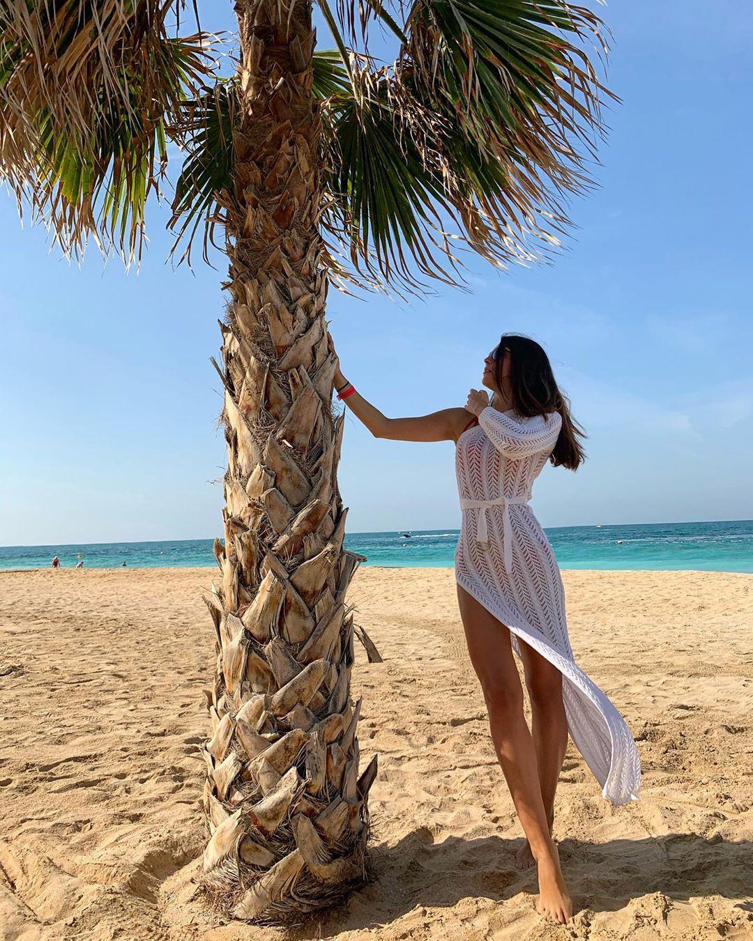 Stefanie Capshield, people in nature, people on beach, palm tree