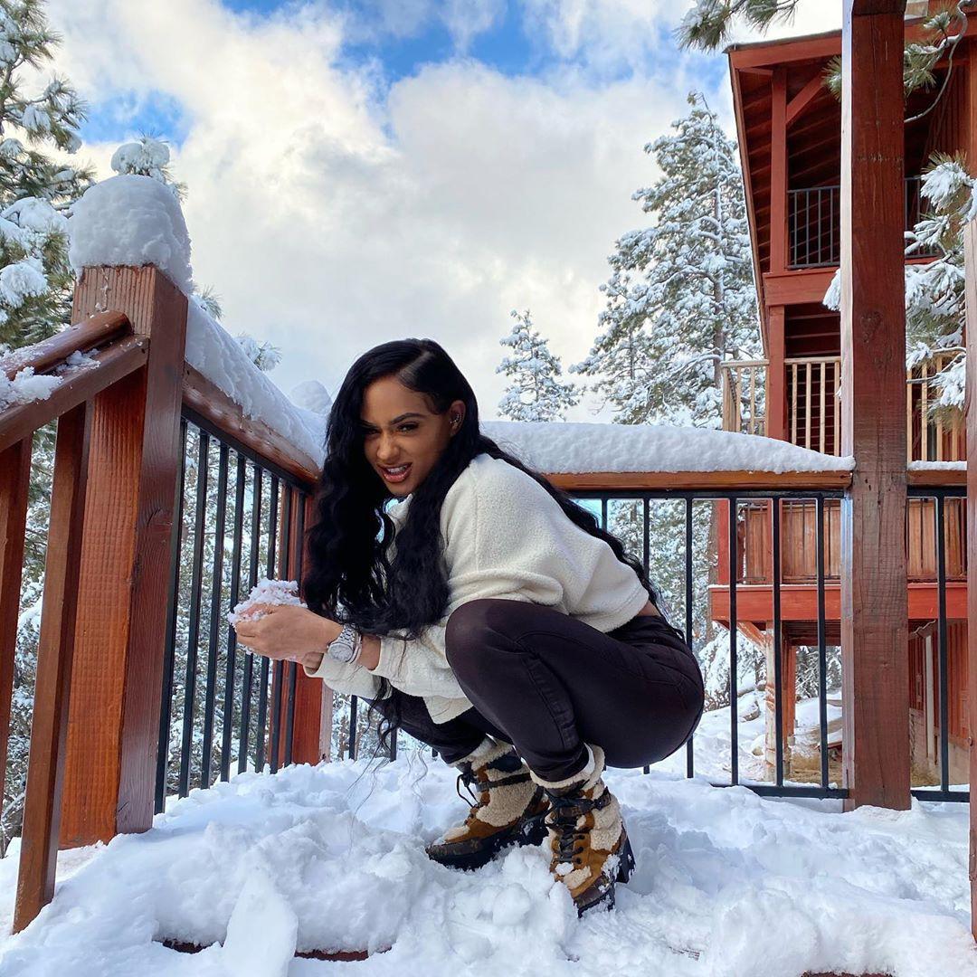 Tori Brixx enjoying life, playing in the snow, footwear