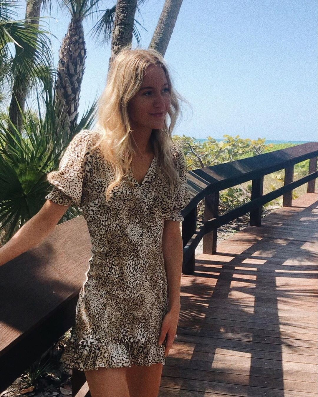 Laura Hudson dress colour outfit ideas 2020, legs photo, blond hairstyle