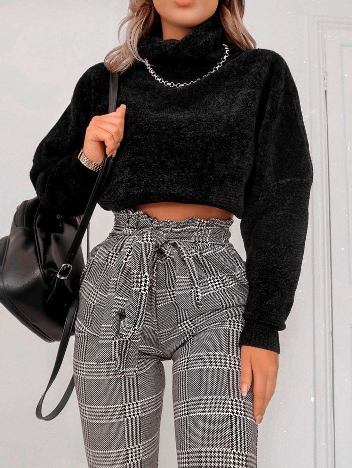 Black classy outfit with crop top, sweater, jeans