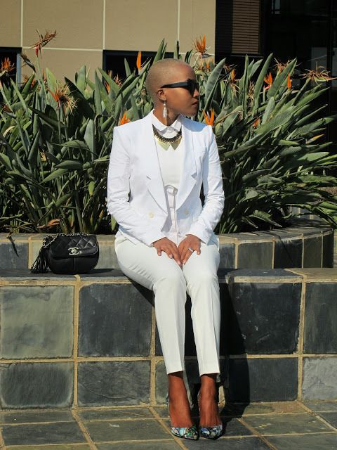 Bald head woman with pants suits dressy