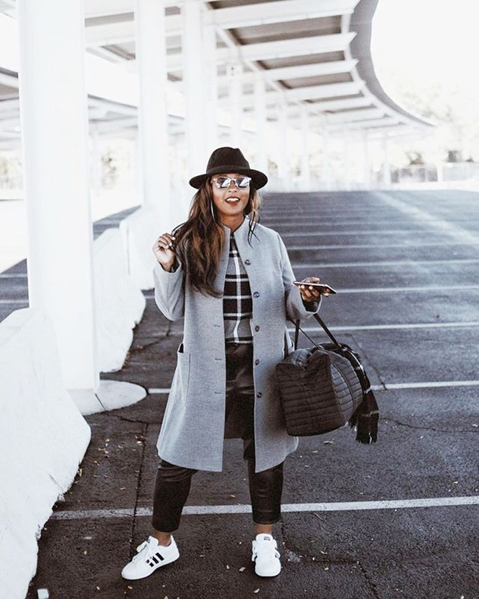 White outfit Stylevore with trench coat, jeans, coat