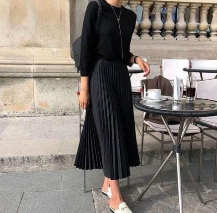 Black colour dress with sweater, skirt