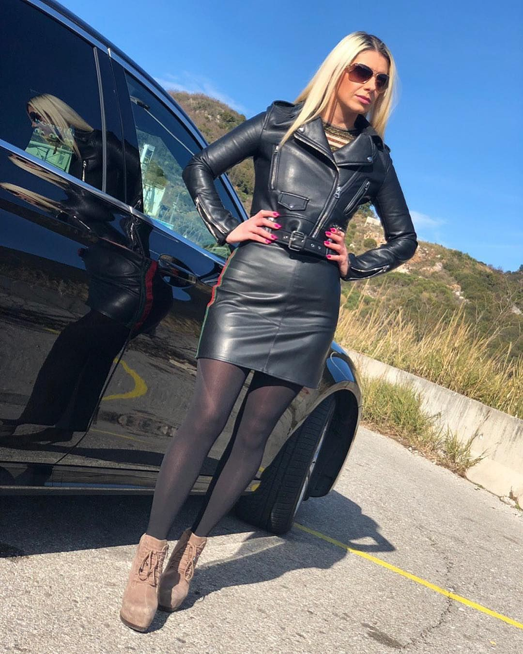 Outfit style with leather jacket, latex clothing, leather skirt