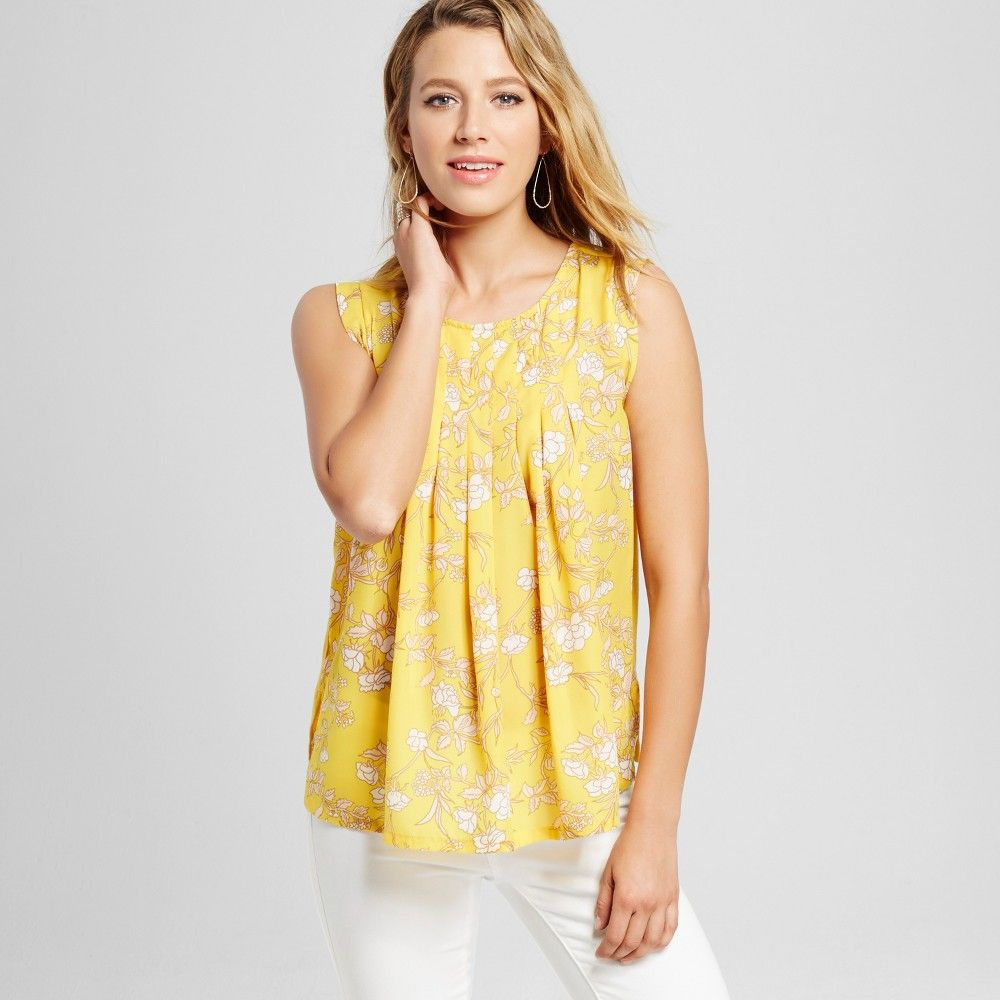 Yellow colour combination with sleeveless shirt, blouse, skirt
