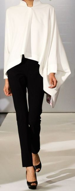 White colour outfit with formal wear, trousers, blouse